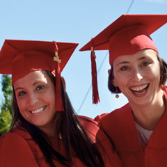 Two graduate students smiling