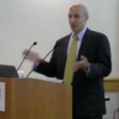 Man talking at podium